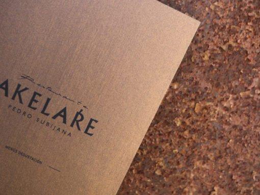 Diseño e impresión cartas de menú Akelarre